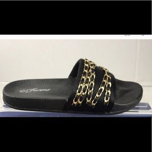 Black slides with gold chains